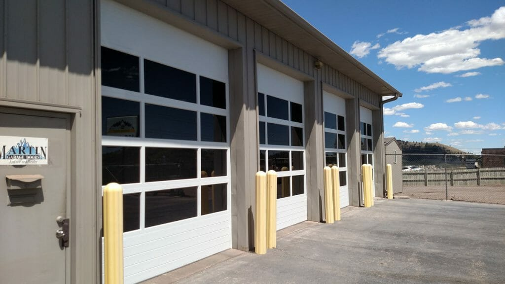 three commercial sectional doors with fullview sections installed.