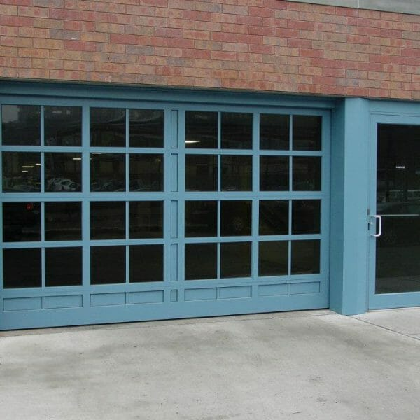 A Blue Custom Glass Door with Matching Entry Door