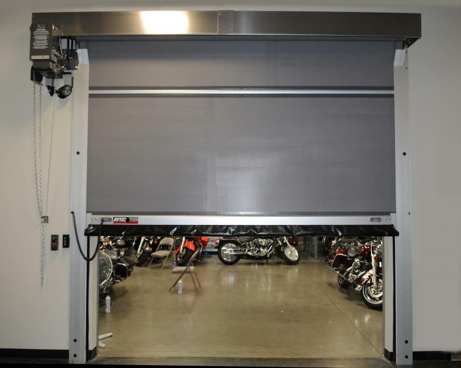 Grey High speed door installed in a warehouse.