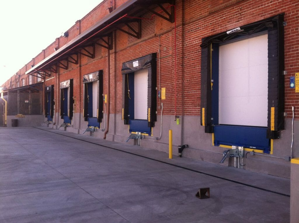 Dock Doors, seals, and levelers in a brick building
