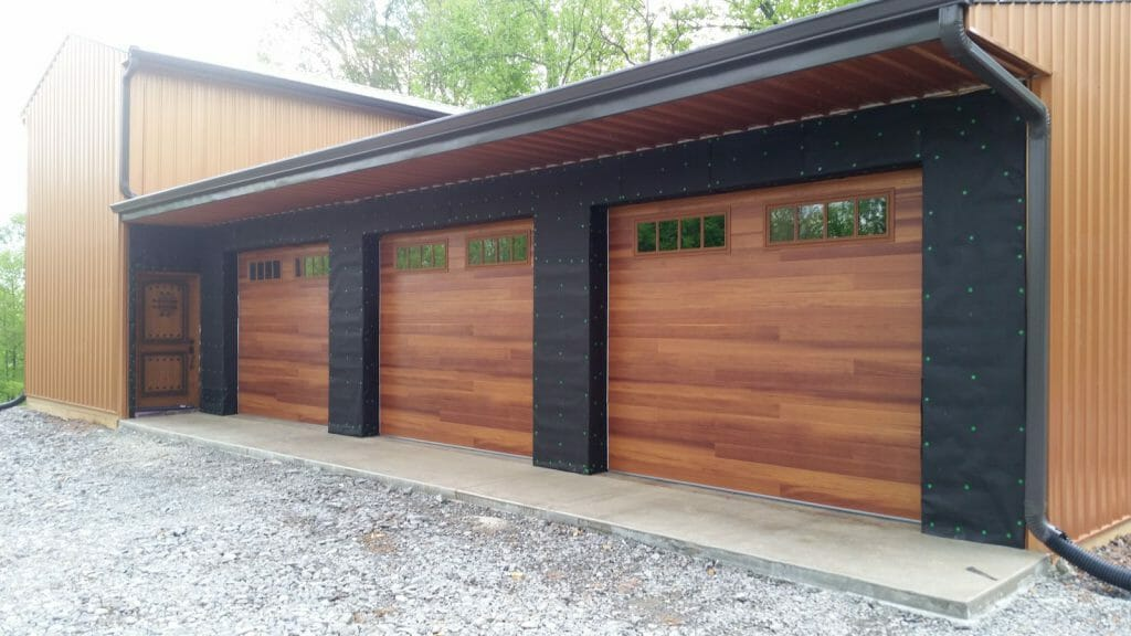 Three Accent garage doors installed with windows