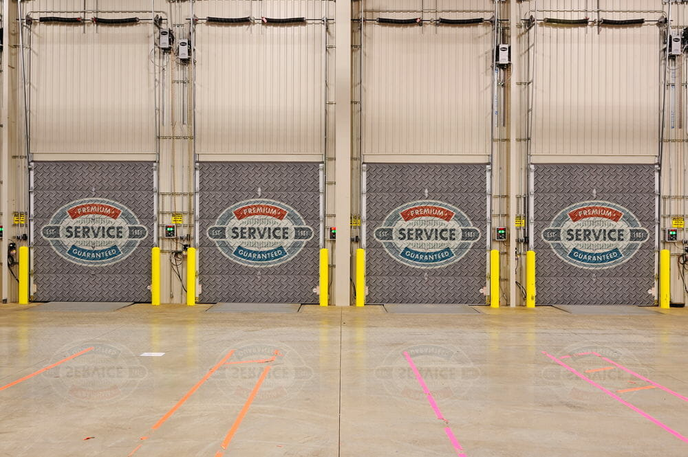 row of commercial sectional doors with custom printed logos