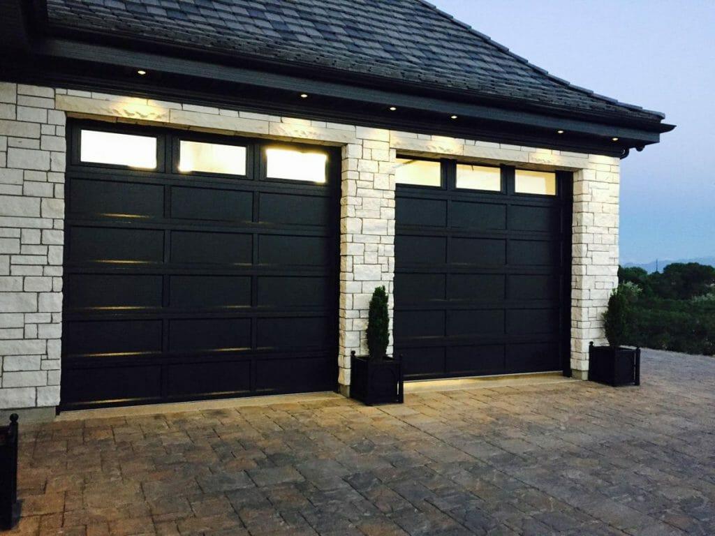 Two black Recessed Panel garage door