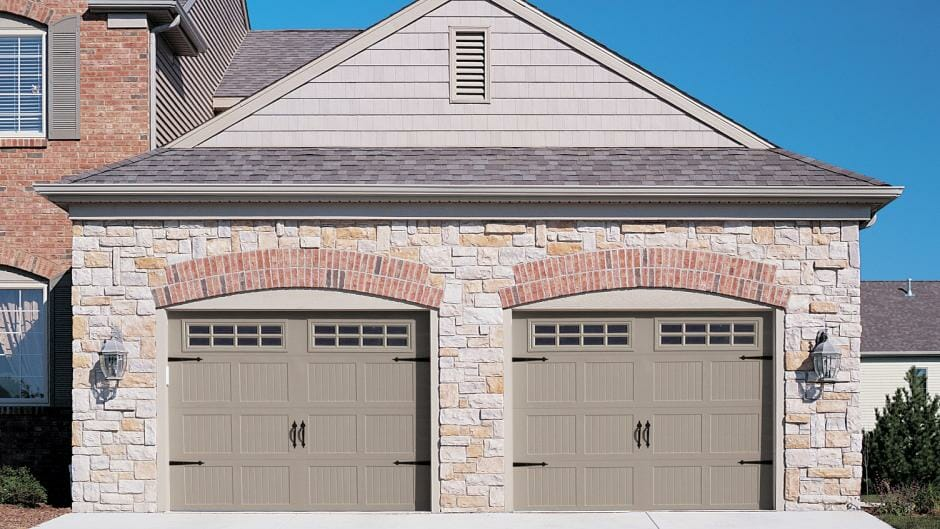 Two Brown garage doors installed side by side.