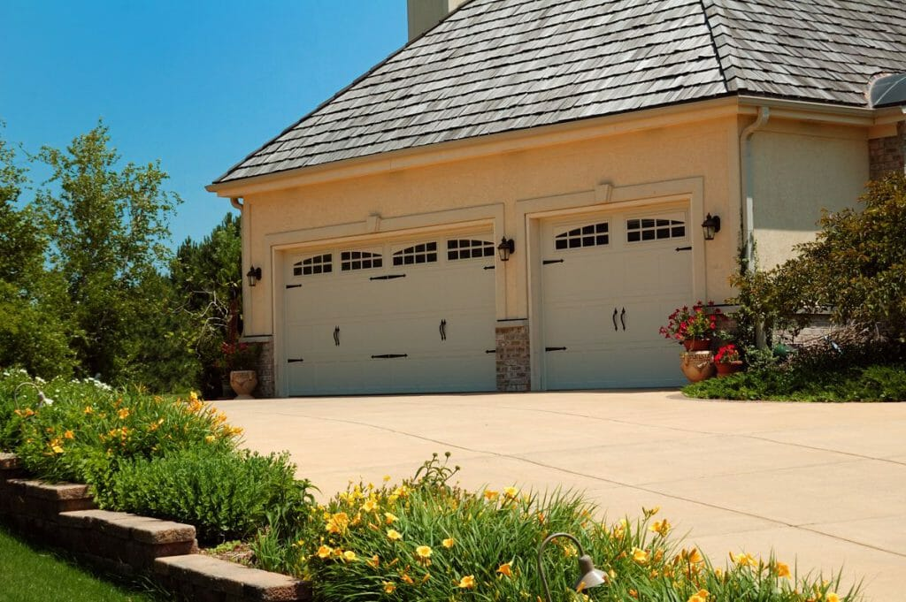 Two CHI Stamped Carriage House Garage Door installed in a garage.