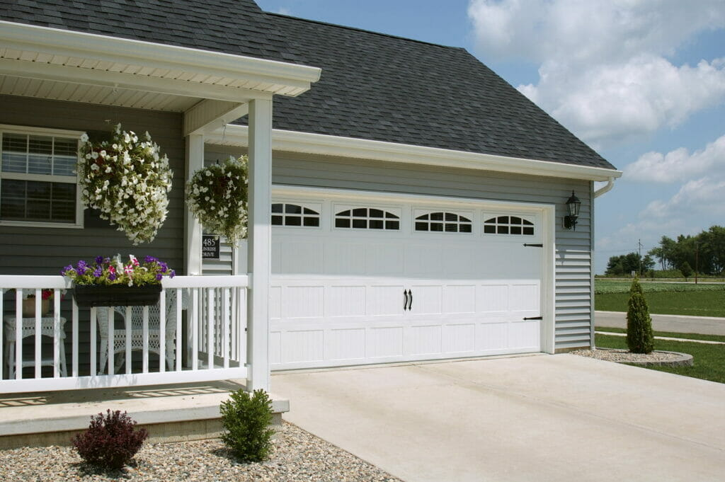 A CHI Stamped Carriage House Garage Door Installed on a house