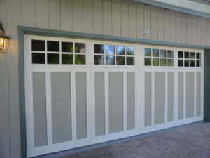 A two tone Wood Overlaty Garage Door that was painted in the field.