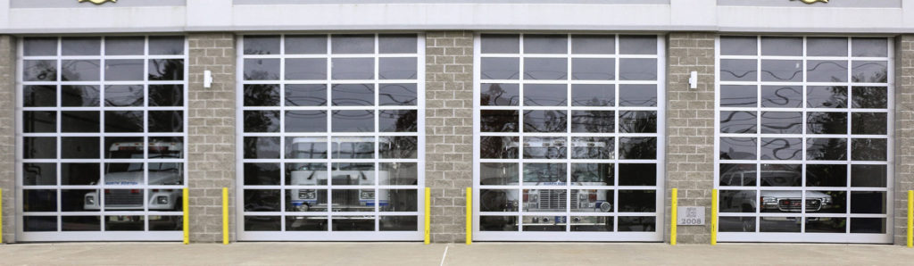 Four Wayne Dalton KAL Full view doors installed in a fire station.