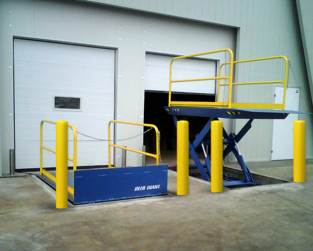 Two Loading Dock lifts installed side by side with overhead doors in the background.