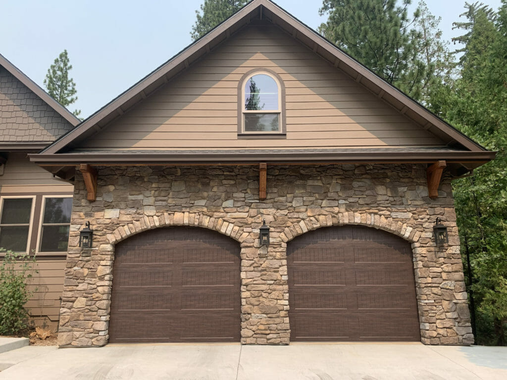 Two CHI Woodgrain garage door installed in a home in Sonora CA.
