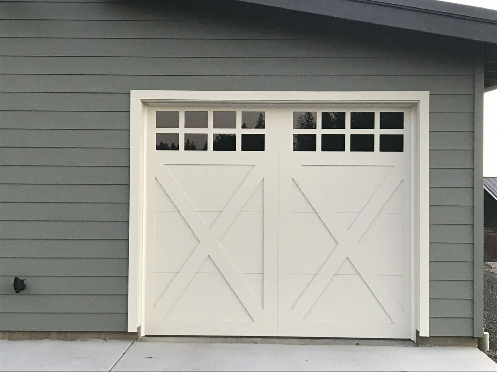 Closeup of a carriage house door installed on a shop.