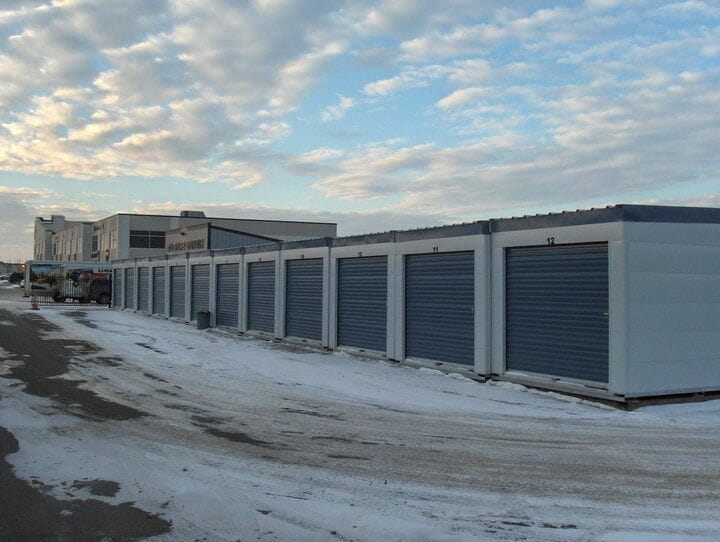 Janus self storage doors in a row with snow on the ground.