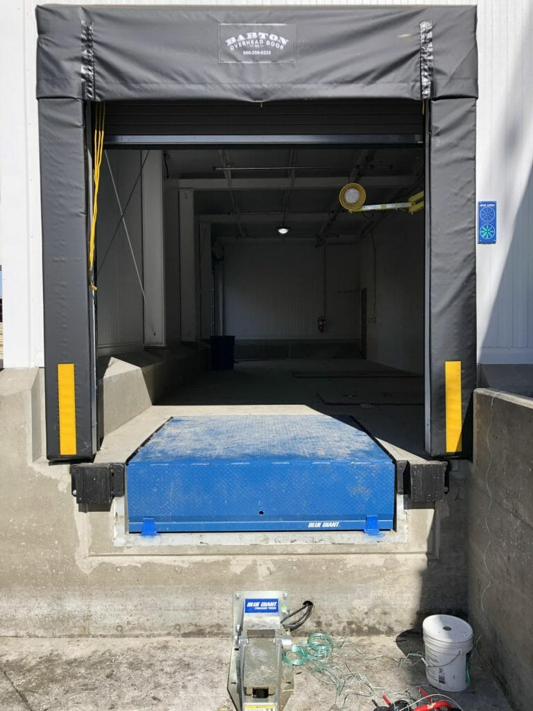 loading dock leveler and shelter installed