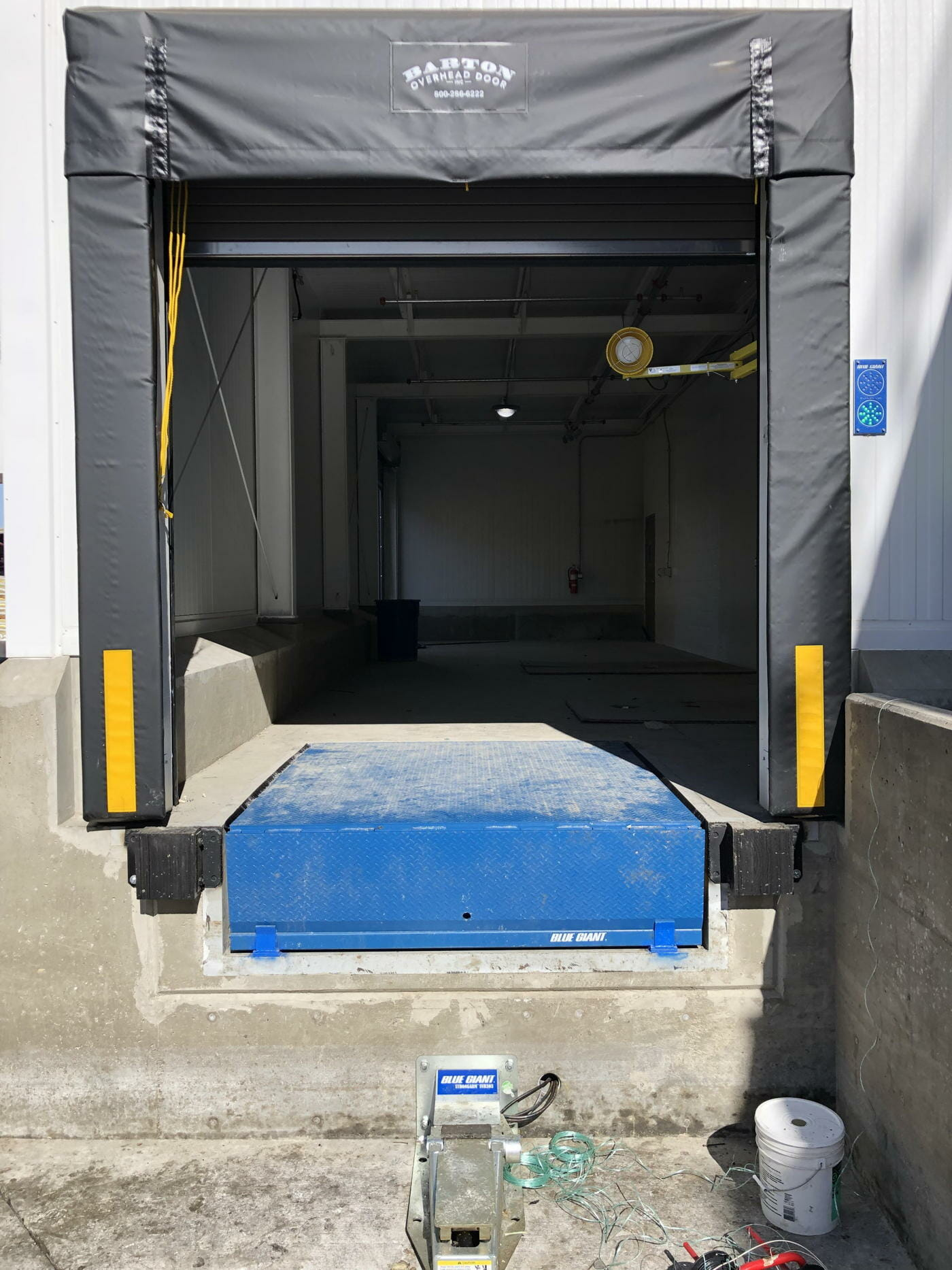 A Blue Giant loading dock, seal, and vehicle restraint installed.