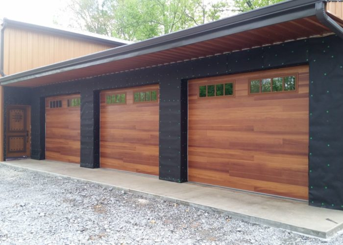 ... Plank garage door with windows ... & Wood Tone Garage Door | Barton Overhead Door Inc.