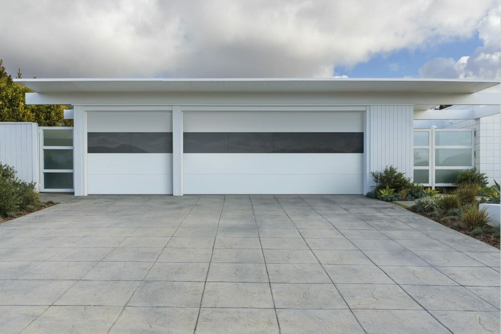Contemporary white garage doors with a edge to edge glass panel.
