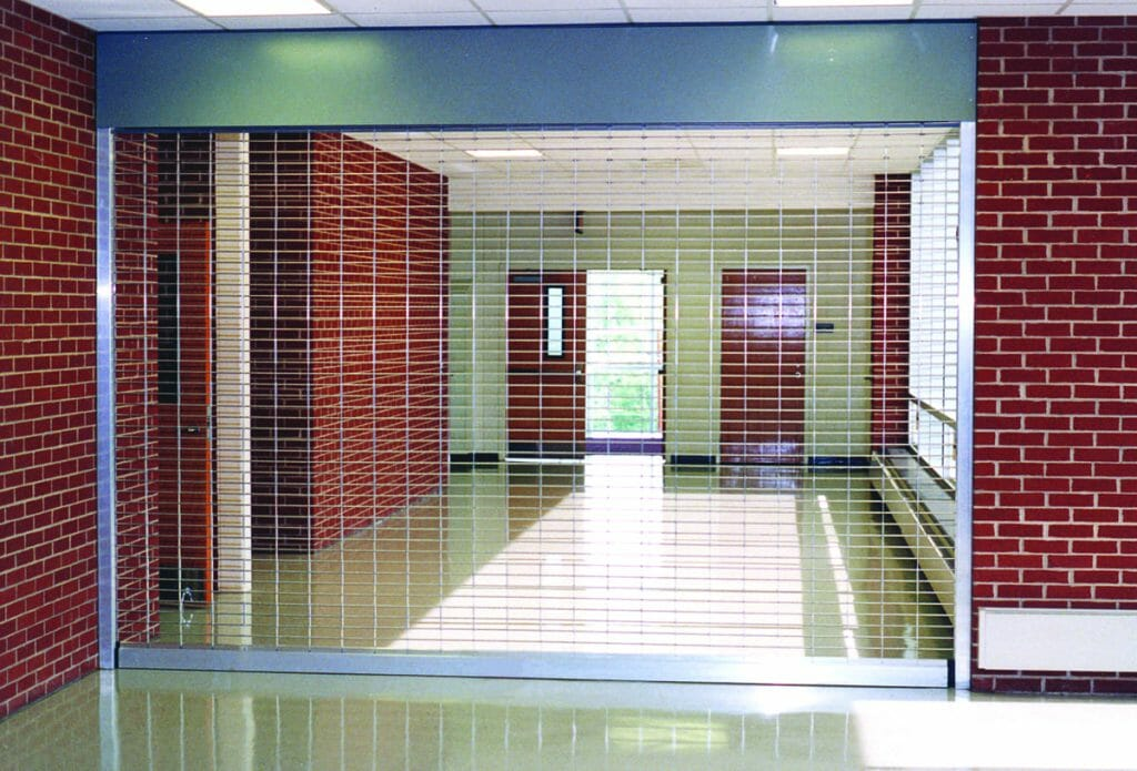 A hallway with a closed security grille.
