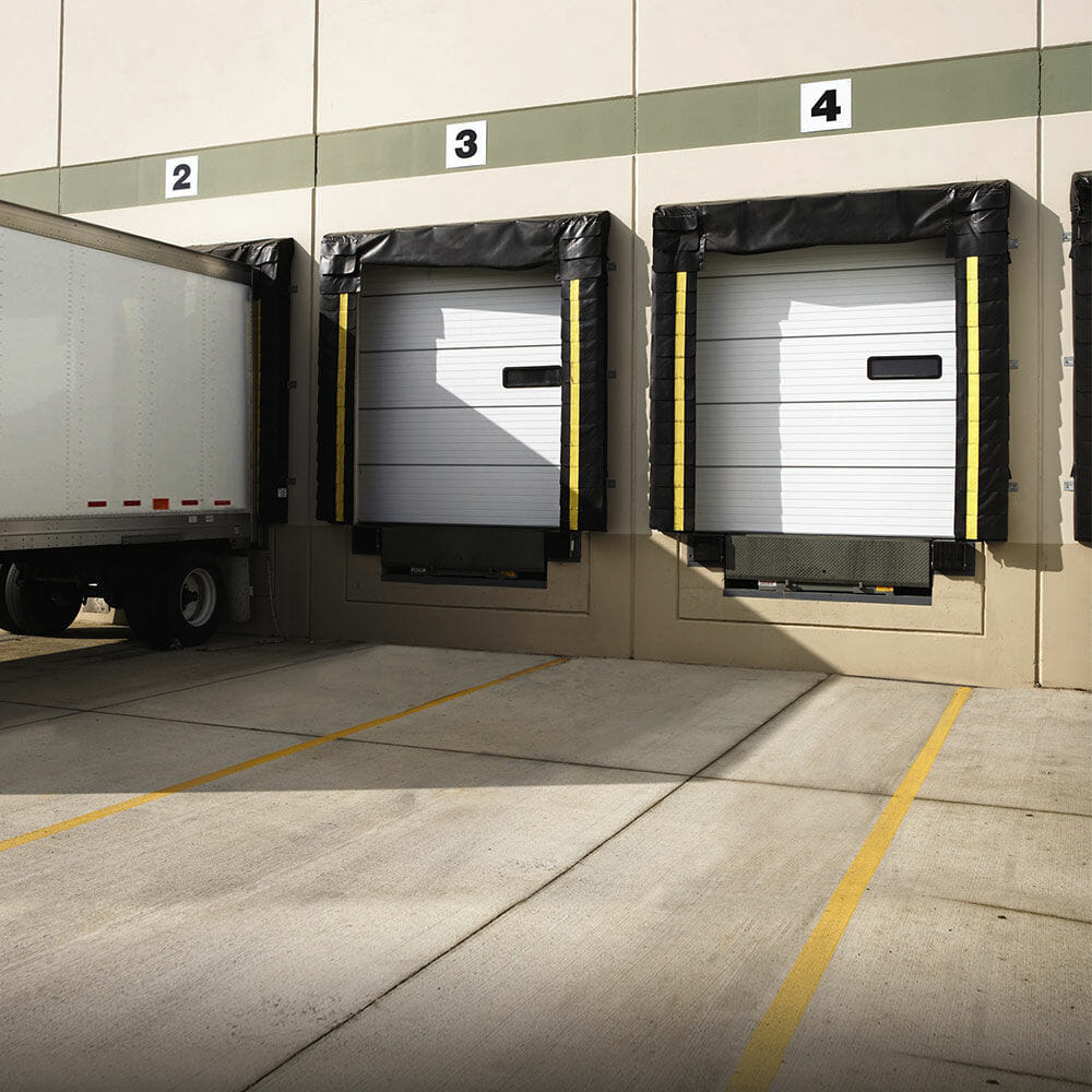 loading dock doors and seals with a semi backed up to one dock.